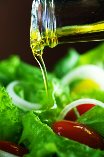 Healthy Salad And Pouring Olive Oil.
